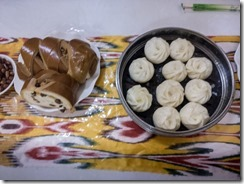 Breakfast of dumplings and currant buns