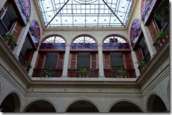 Stained glass sets off the courtyard
