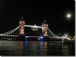 The Olympic rings under an illuminated Tower Bridge