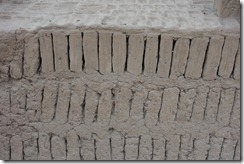 Bookshelf layout of mud bricks