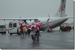 Disembarking - umbrellas instead of a jetway
