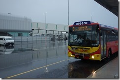 Waiting for the bus in the rain at Christchurch Airport