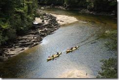 Kayaks weaving through at low tide