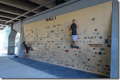 Rock climbing wall under a flyover