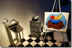 3D objects are monochrome, 2D painting in colour. Clever!