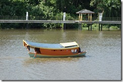 Sampan ferry across the river