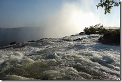 Like the days, the water rushes by - at the top of Victoria Falls