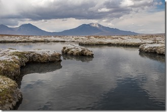 Hot spring pools with mountains in the background