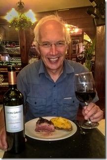 Happy now he has his wine and steak