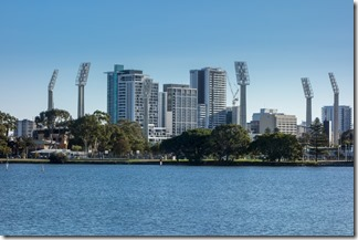 The floodlights of the WACA dominate the skyline from the far side of the river