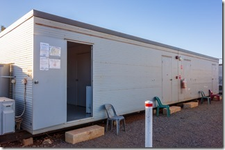 Shipping container converted to four en suite rooms
