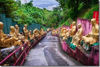 Golden Buddhas lining the path